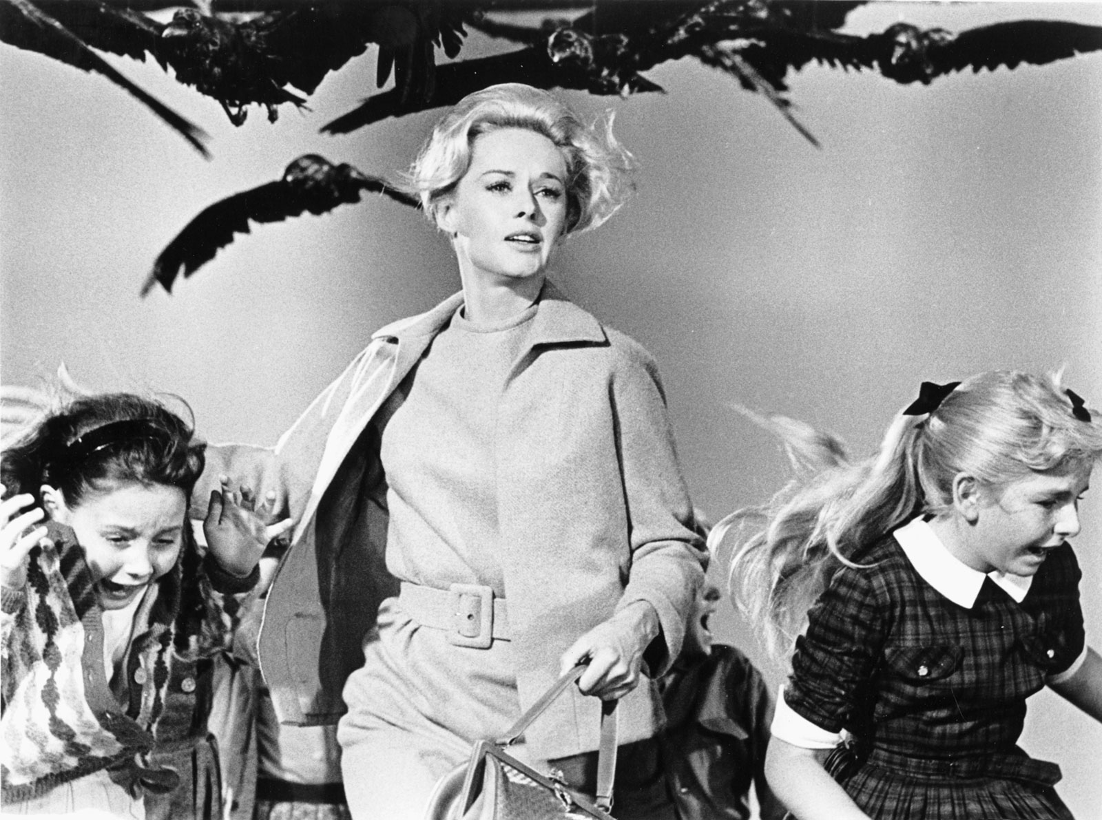 Tippi Hendren as Melanie Daniels helping children escape attack in Hitchcock's 'The Birds' – copyright Universal Pictures