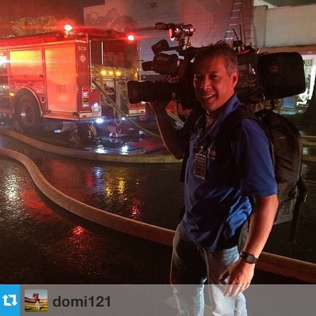 Michael Domalaog using his TVUpack to report on a house fire. (instagram)