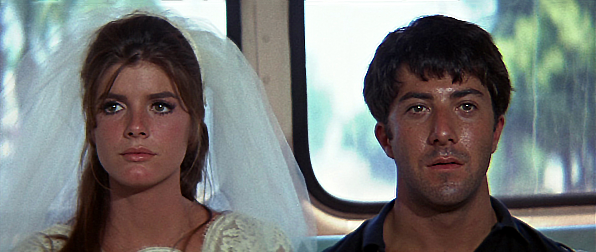 The Graduate (long shot ending) with Katherine Ross (Elaine) and Dustin Hoffman (Benjamin) after running out on Elaine's wedding - copyright MGM Pictures
