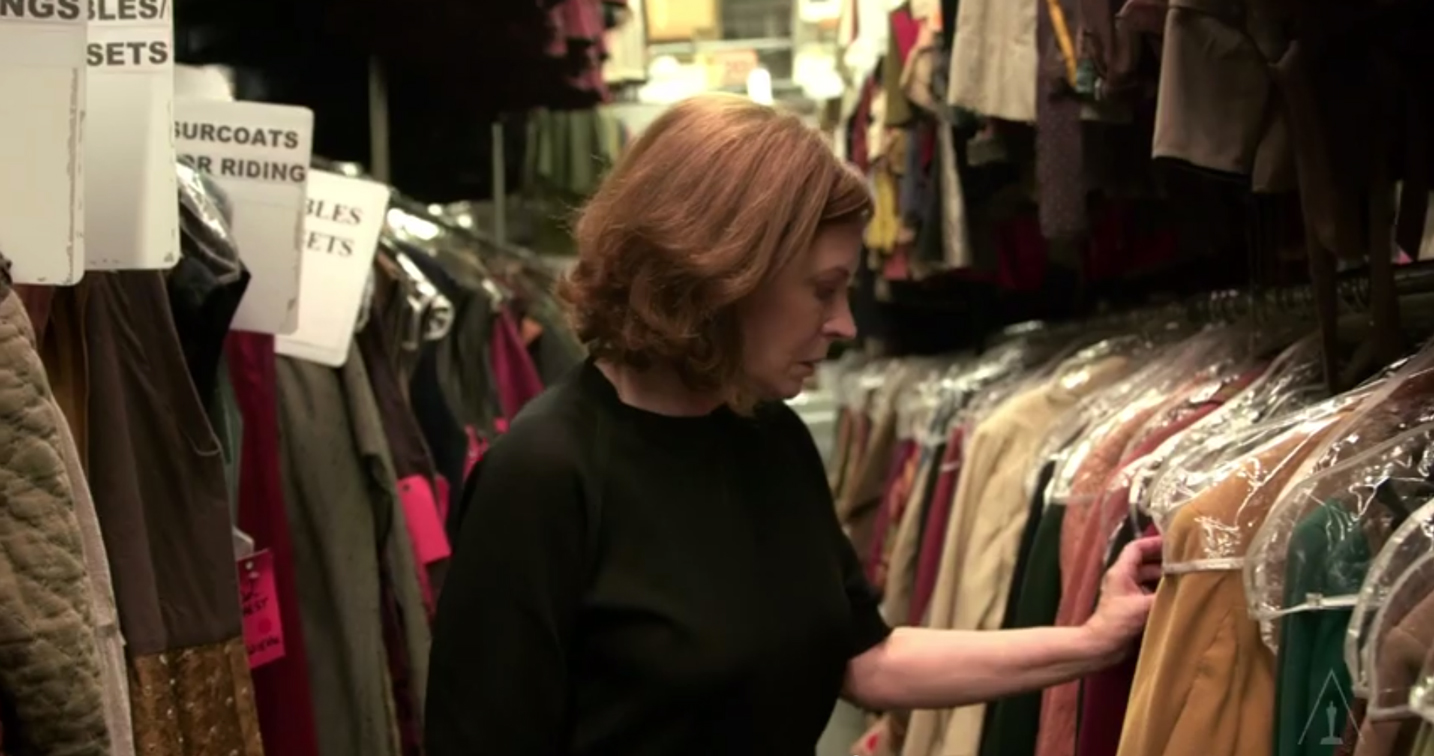 Betsy Heimann searching for costumes.