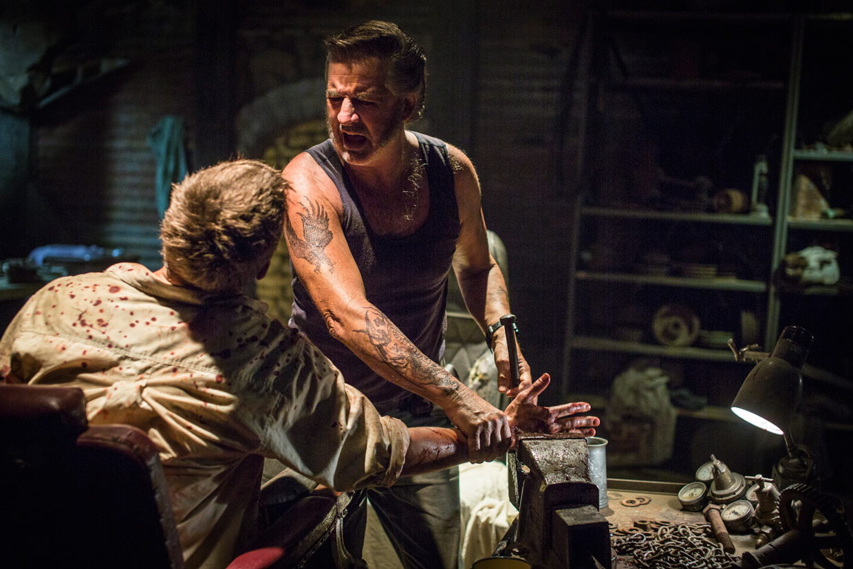 WolfCreek2_John-Jarratt-as-Mick-Taylor-and-Ryan-Corr-as-Paul_Micks-torture-chamber-5