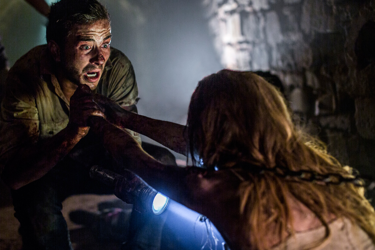 WolfCreek 2, Ryan Corr as Paul in a tunnel with Mick Taylor a victim.