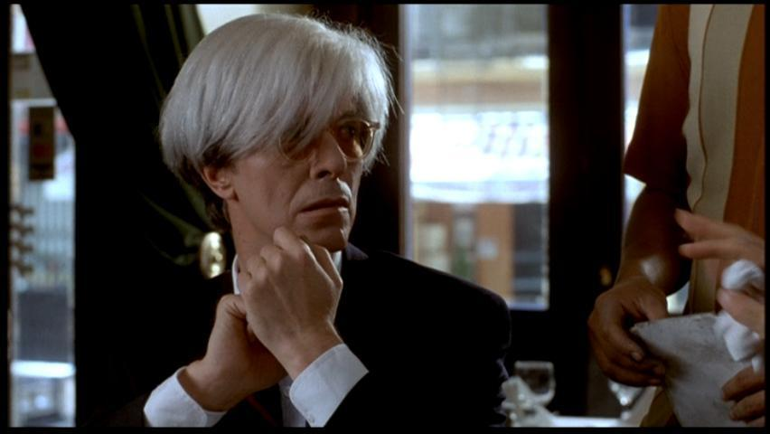 Bowie playing Basquiat's friend and mentor Andy Warhol, in 'Basquiat' (1996).
