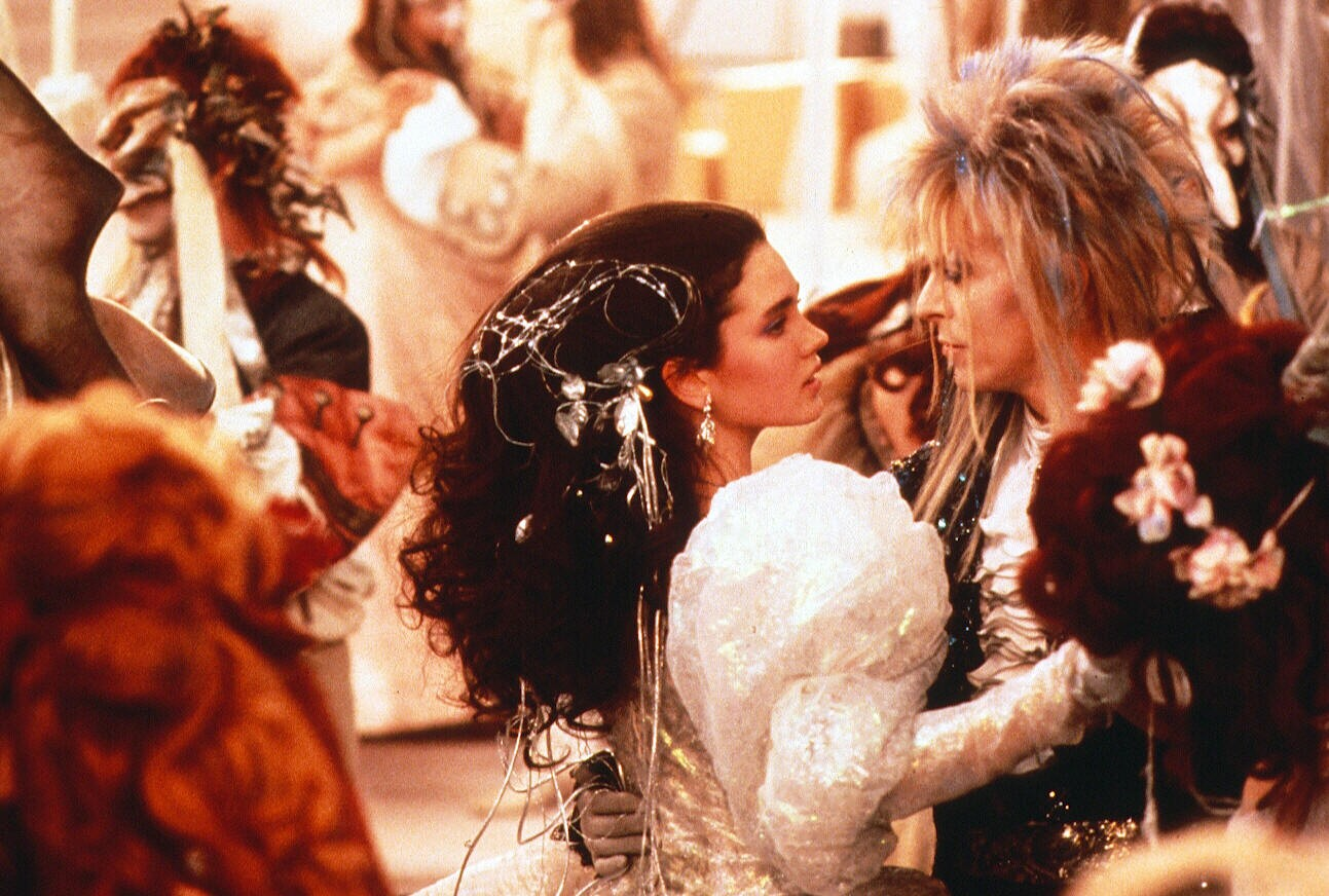 Bow playing Jareth the Goblin King alongside Jennifer Connelly's Sarah, in 'Labyrinth' (1986).
