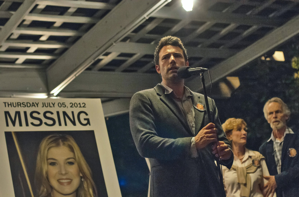 "Nick Dunne (Ben Affleck) finds himself the chief suspect behind the shocking disappearance of his wife Amy (Rosamund Pike), on their fifth anniversary. 20th Century Fox's feature film ""Gone Girl""."