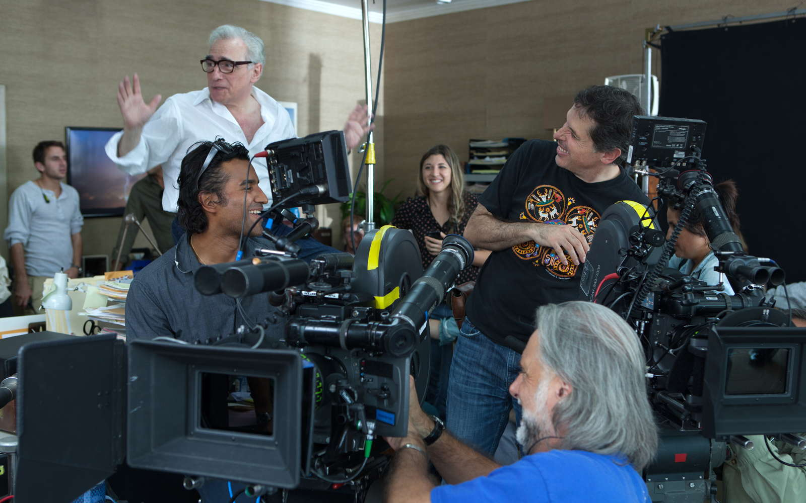 Scorsese chatting with his camera crew, on the set of 'The Wolf of Wall Street' (image: Paramount Pictures).