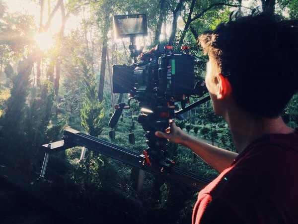 Josh Miller slides a beautiful shot through a WWII graveyard with a setting sun, on the set of 'Burma Road' (image: © Monarex).