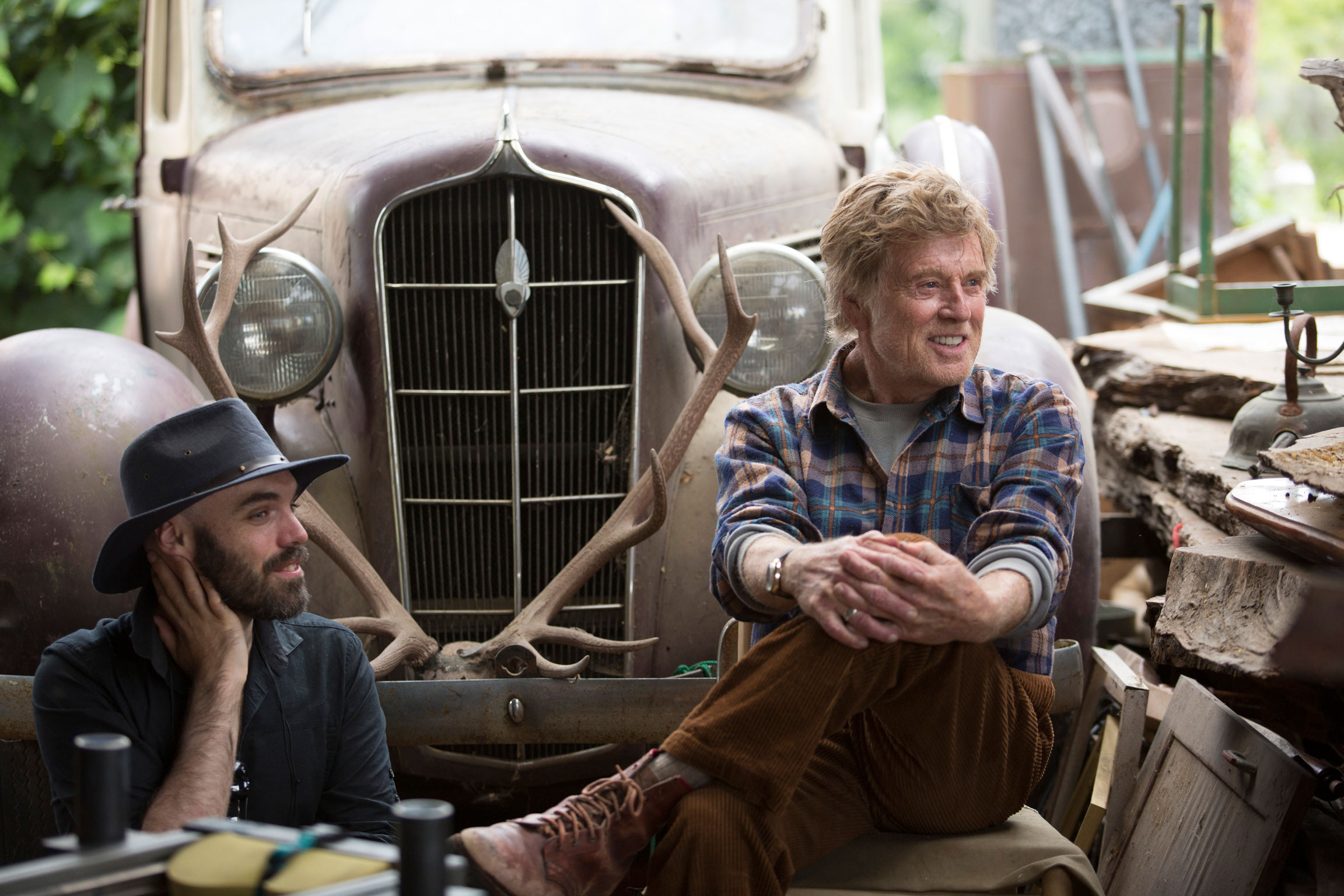 David Lowery directs screen legend Robert Redford on the set of 'Pete's Dragon' (image courtesy of Walt Disney Productions).(