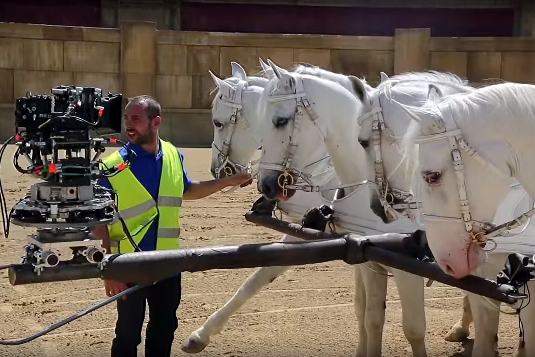 Rigging the camera to the horses, to shoot the actors while they're riding the chariots.