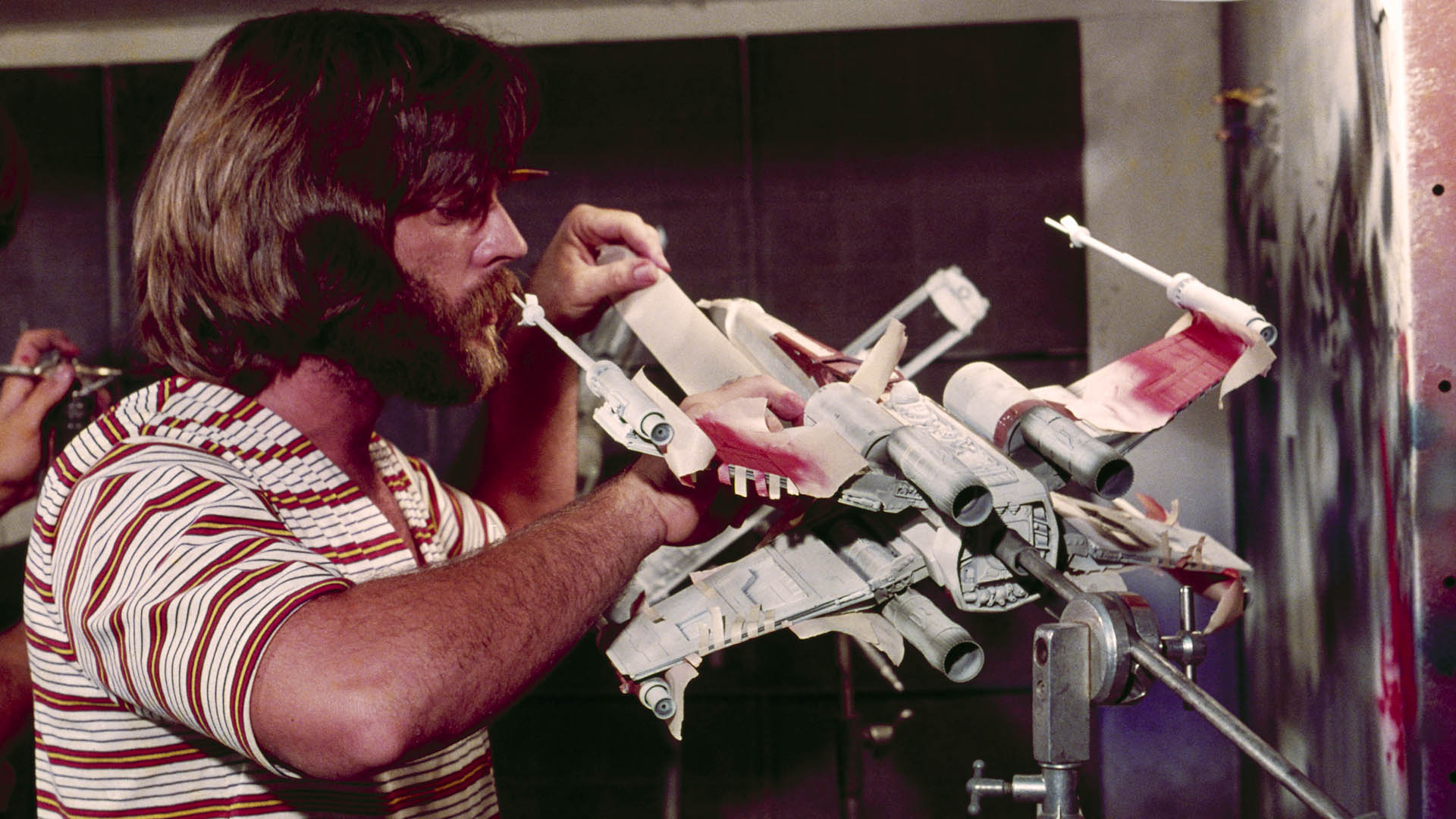 John Dykstra adds the finishing touches to an X-wing fighter (image: LucasFilm).