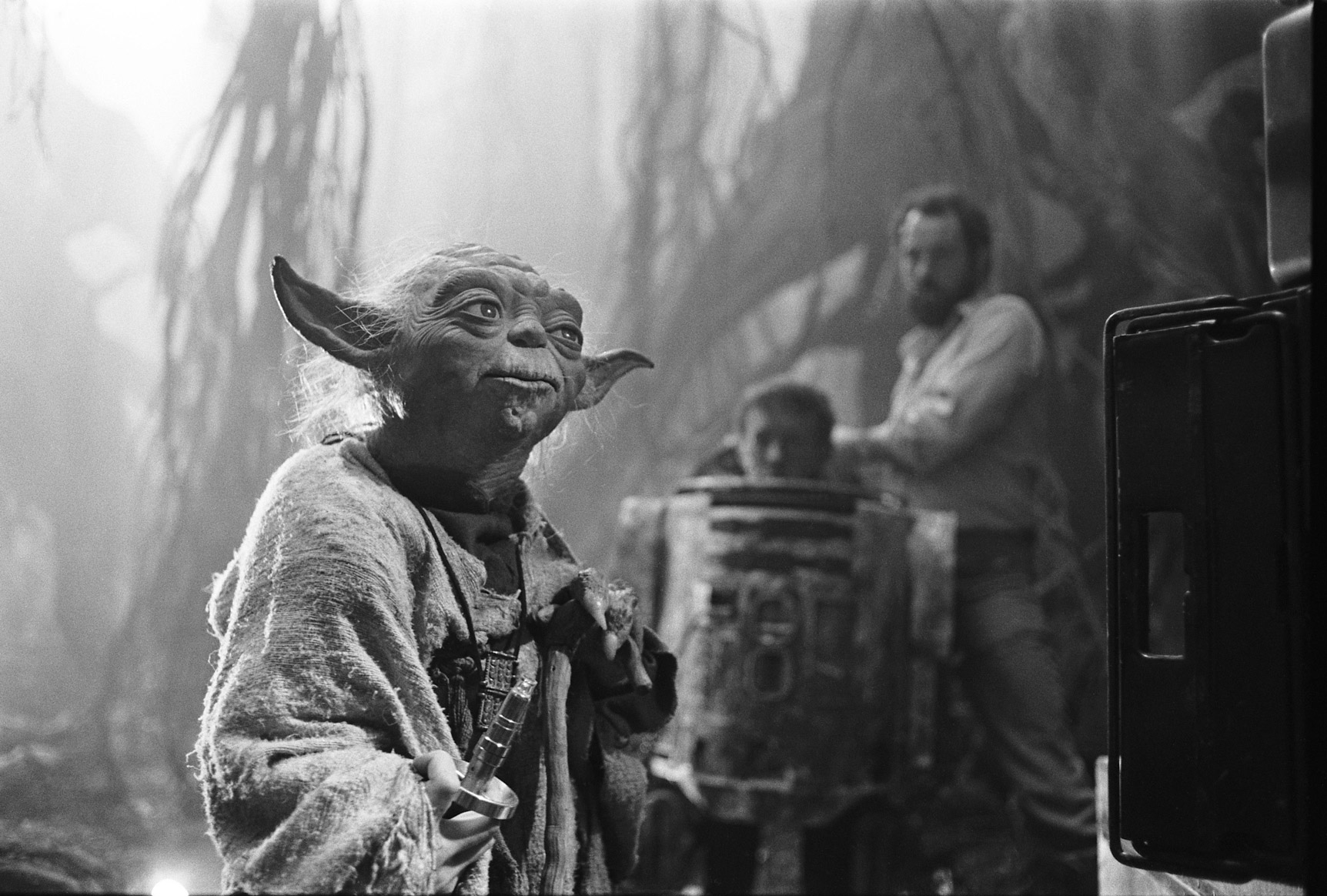 Preparing Yoda for his 'fight' scene with R2-D2 (Kenny Baker, pictured) on the set of Empire Strikes Back (image: LucasFilm).